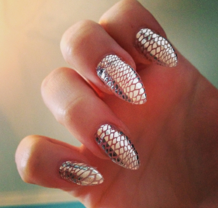 fish or snake skin scales, silver metallic and smooth, on long sharp nails, original and unusual idea