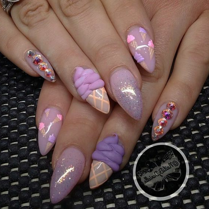 ice-cream cone 3D shapes, on pastel pink-colored manicure, decorated with colorful rhinestones, glitter and tiny ice cream stickers, in pink and violet