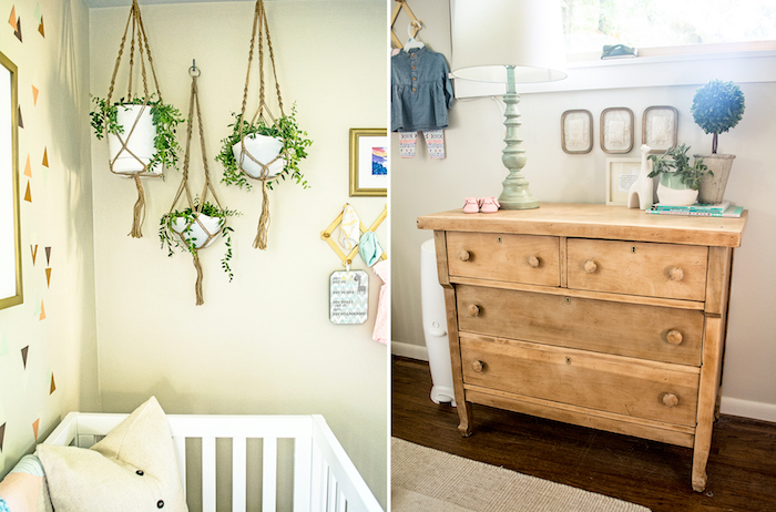 green plants in white pots, hanging from the ceiling, near white crib, massive wooden chest of drawers, baby girl themes