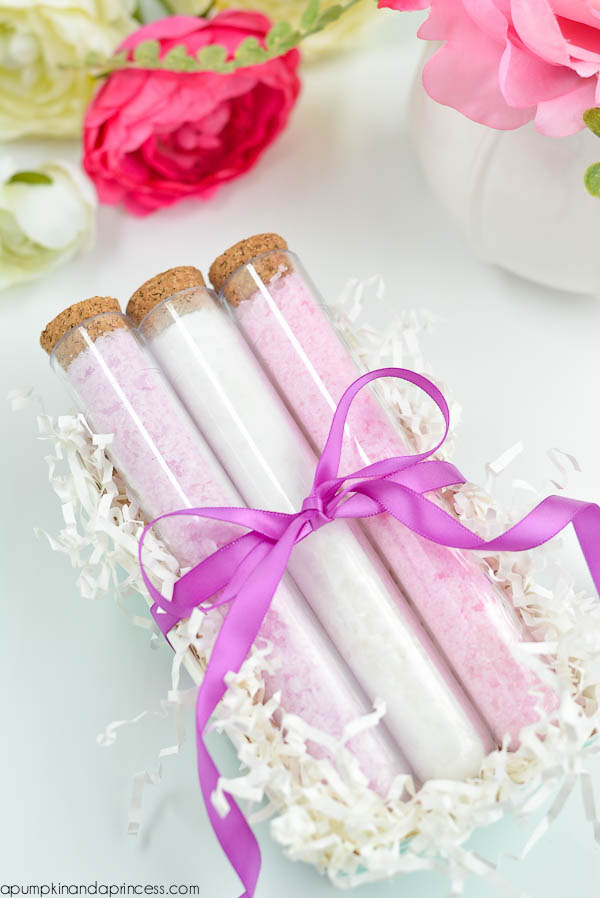 bath salts in pale pink and white, inside three glass vials, tied with purple ribbon, with cork stoppers, mothers day presents