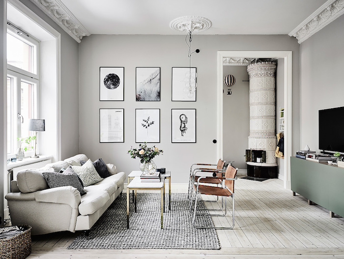 living room paint colors, pale grey walls, light beige laminate floor, off-white sofa and brown chairs,grey spotted carpet