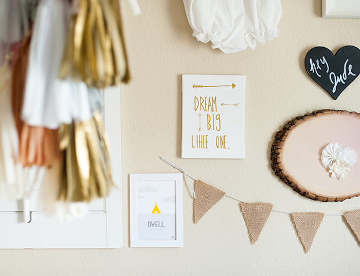 tassels in golden, white and pink colors, hanging near cream wall, baby girl nursery ideas, decorated with burlap banners, motivational posters and others