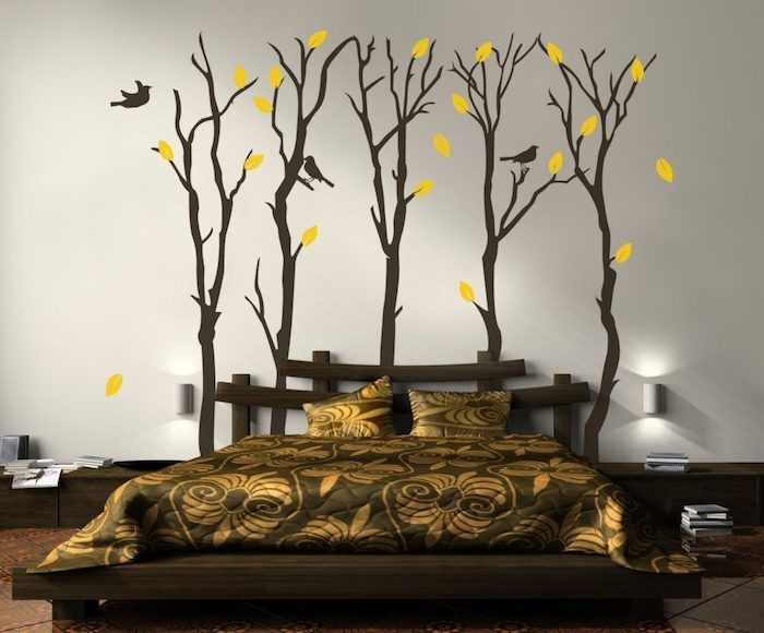 yellow leaves and three small birds, on five dark brown trees, large wall art, on white wall, near a brown bed, with asian-inspired headboard
