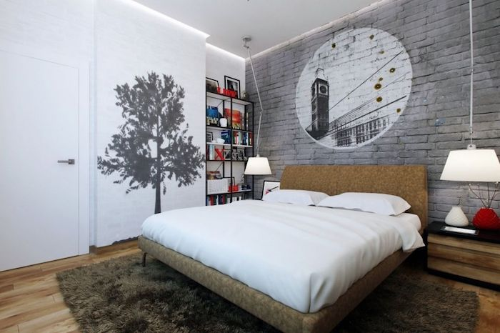 tree mural in black, on a white wall, and an image of big ben, in a white circle on a gray brick wall, wall decor ideas, inside a double bed bedroom