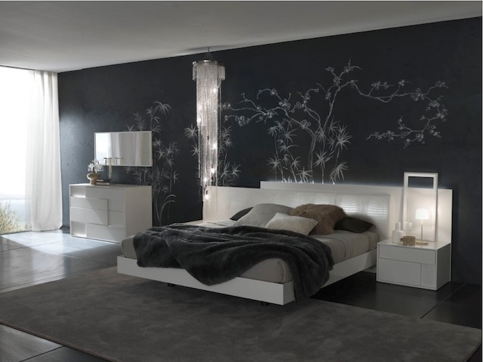 spacious dark bedroom, with black wall, decorated with white painted shapes, resembling bamboo plants, black tiled floor, dark gray carpet
