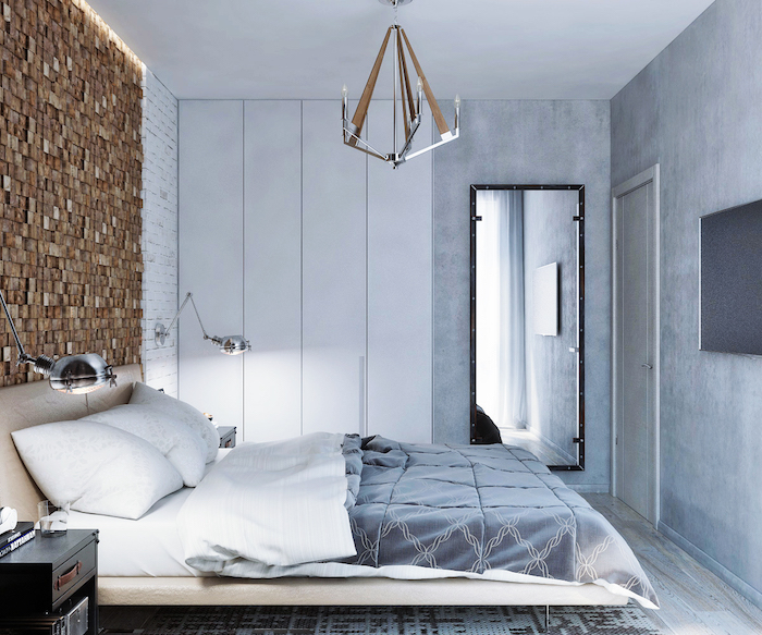 modern room design in gray, one wall covered in brown mosaic, bedroom decorating ideas, cream bed with gray bedding, large mirror and modern chandelier