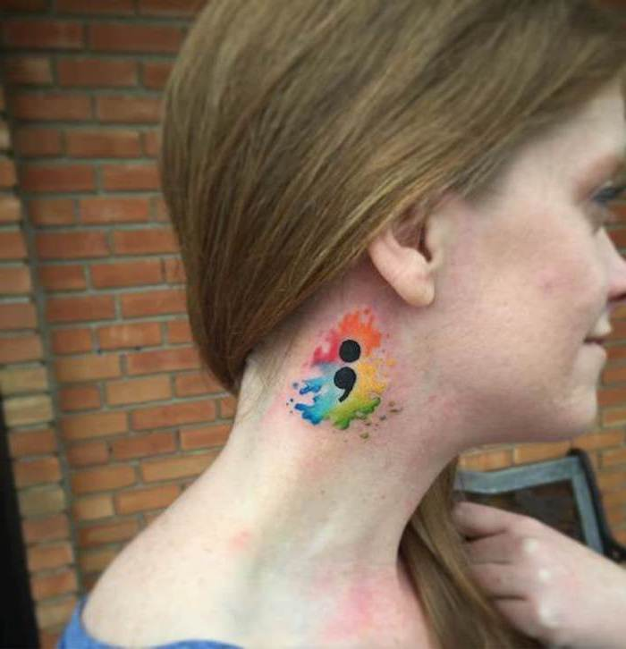 semicolon movement tattoo, with rainbow colors, and a splashed watercolor effect, on the side of a smiling, young girl's neck