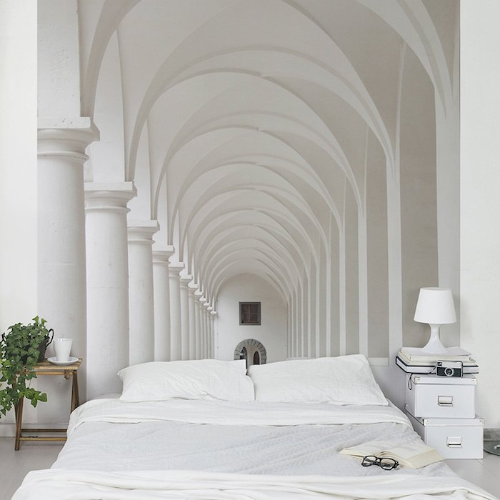 bedroom decorating ideas, 3D effect photo wallpaper, depicting a white tunnel with pillars and arches, near a white double bed