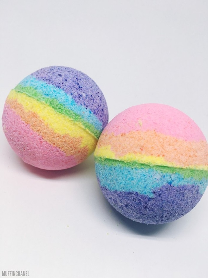 multicolored striped rainbow bath balls, a set of two, placed on a white background