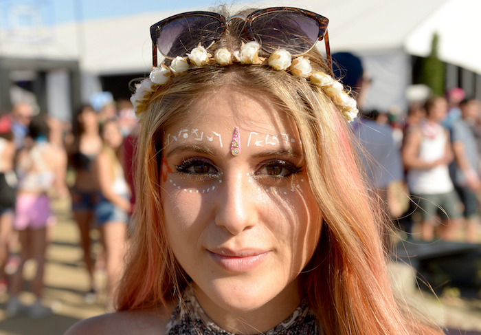 peach colored highlights, on long blonde hair, young woman with nude beige lipstick, and face decorated with white paint, cute makeup looks, flower crown and sunglasses
