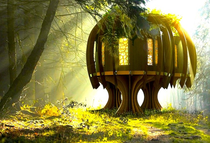 digitally created image of a treehouse, modern structure with stained glass windows, built on wooden platforms, inside a sunlit forest