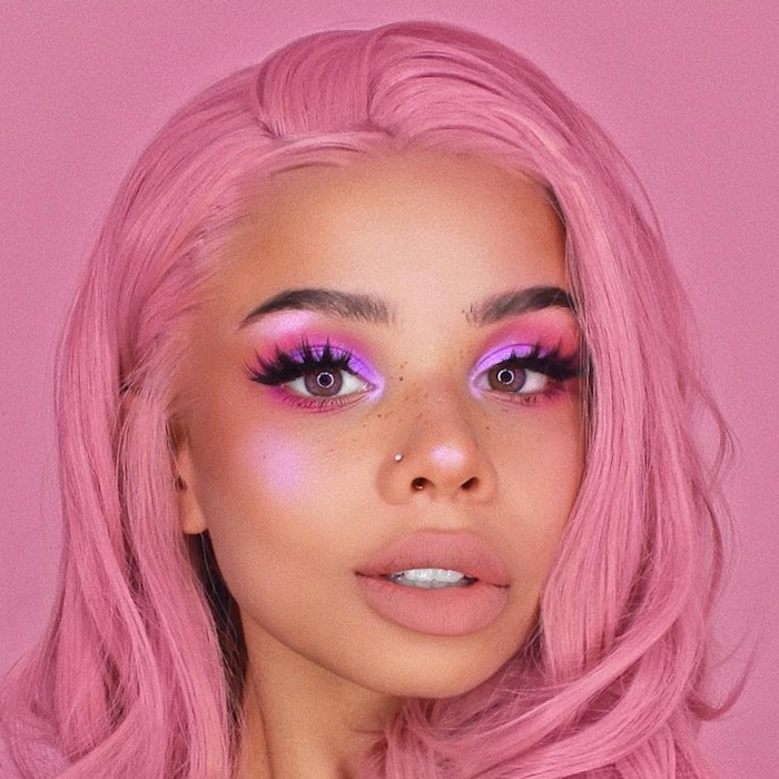 bubblegum pink hair, on girl with bronze skin, wearing eyeshadow in different shades of pink, and nude pink lipstick, festival makeup
