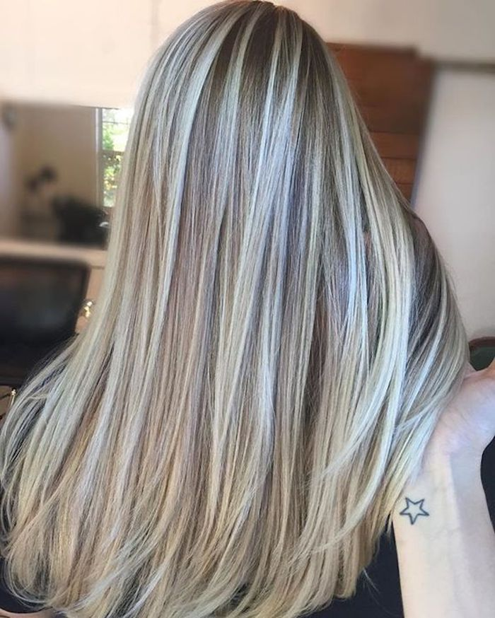 platinum blonde highlights, on long brunette hair, straightened and smooth, brown and blonde hair, hand holding several strands