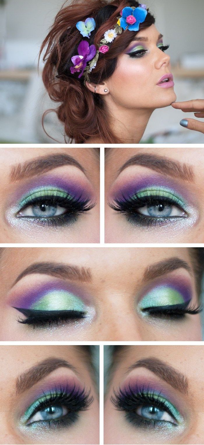 flowers decorating the hair of a brunette woman, with strong make up, in light teal and purple, with black eyeliner, and fake lashes, festival makeup, nude pink lipstick