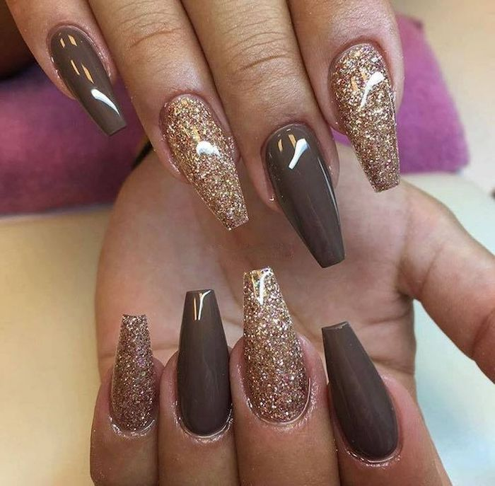 coffin nail designs, smooth dark beige, and rose gold-colored nail polish, with fine glitter, on the eight visible fingers, of two hands