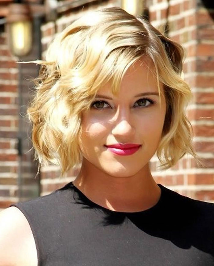 minimalistic black sleeveless top, worn by smiling diana argon, with hot pink lipstick, and vintage-inspired wavy bob, with side part