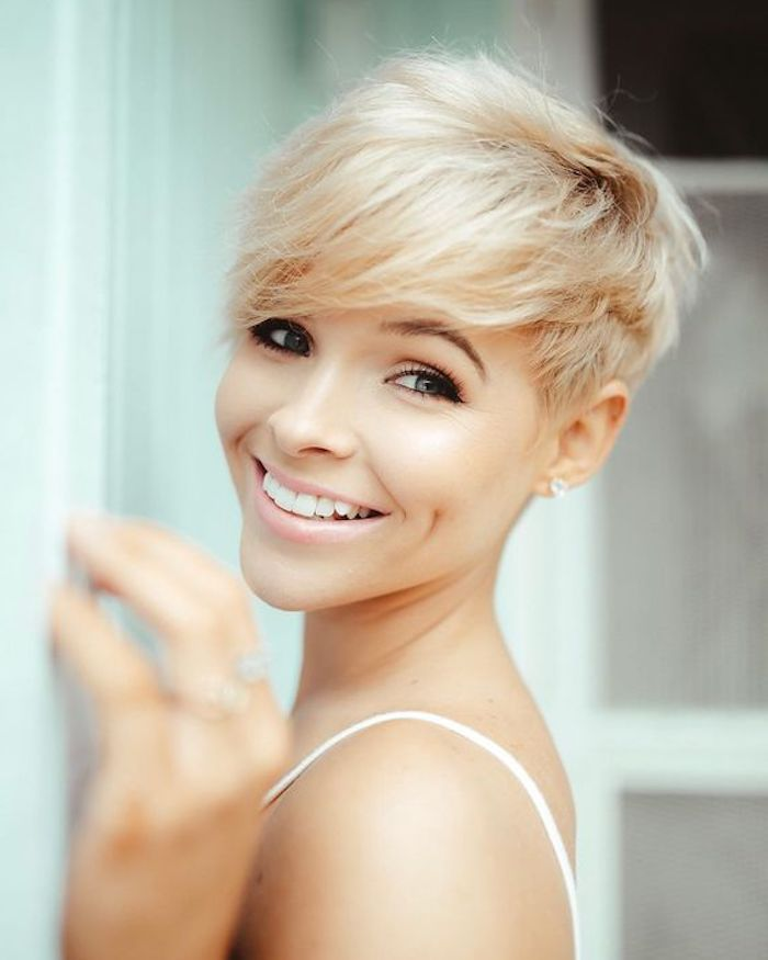 pale nude pink lipstick, and strong black mascara, worn by smiling, dimpled young woman, with textured platinum blonde pixie cut, hairstyles for women with thin hair, dark blonde roots and side bangs
