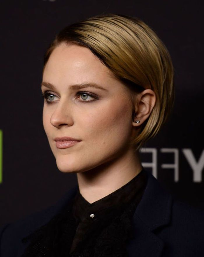 slicked blonde bob, with dark roots, tucked behind the ear, worn by evan rachel wood, hairstyles for women with thin hair, in a black shirt, and wearing discrete make up