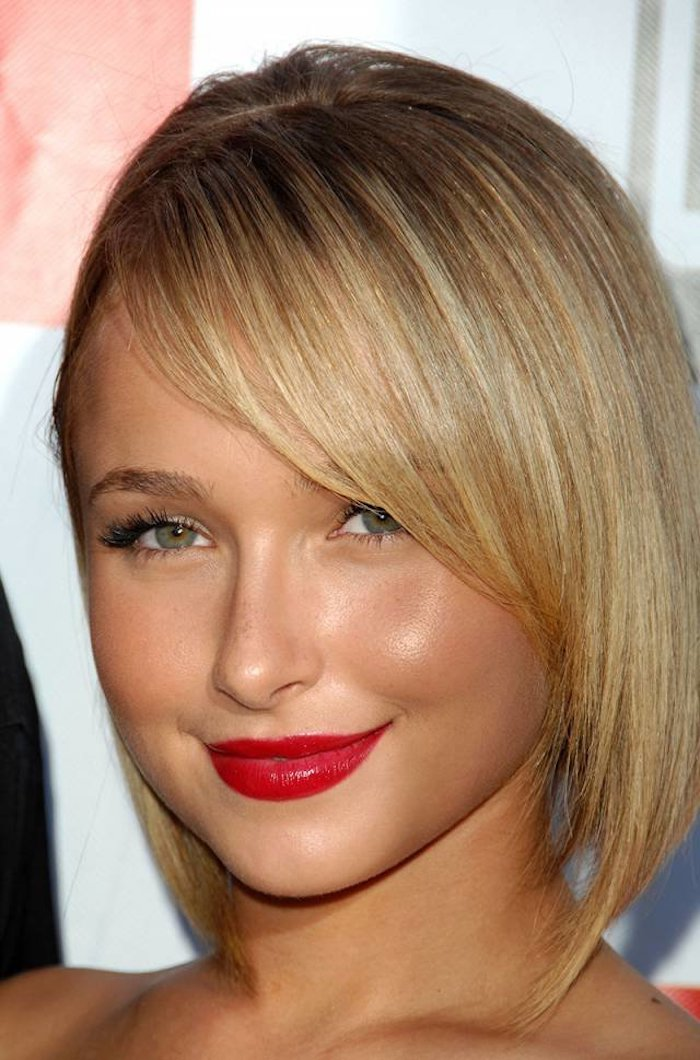 vivid red lipstick, worn by hayden panettiere, with fake lashes, short hairstyles for fine hair, asymmetrical blonde bob, with side bangs, and dark blonde roots