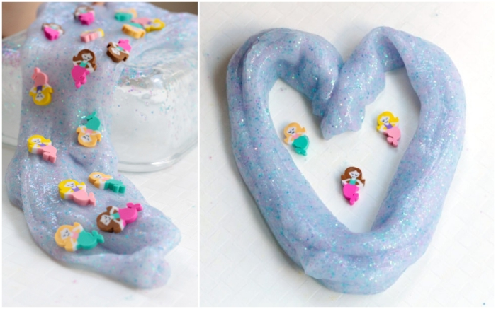 mermaid goop in light blue, with fine pink and blue glitter, elmer's glue slime, decorated with tiny mermaid-shaped figurines, made from colorful foam