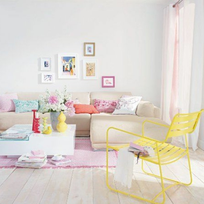 yellow chair inside a bright room, decorated with pastel colors, how to decorate a living room, containing a beige corner sofa, with multicolored cushions