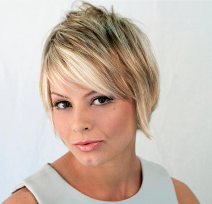 pale duck's egg sleeveless top, worn by woman with dark eyes, with a retro inspired, layered and textured pixie cut, dark blonde with platinum highlights