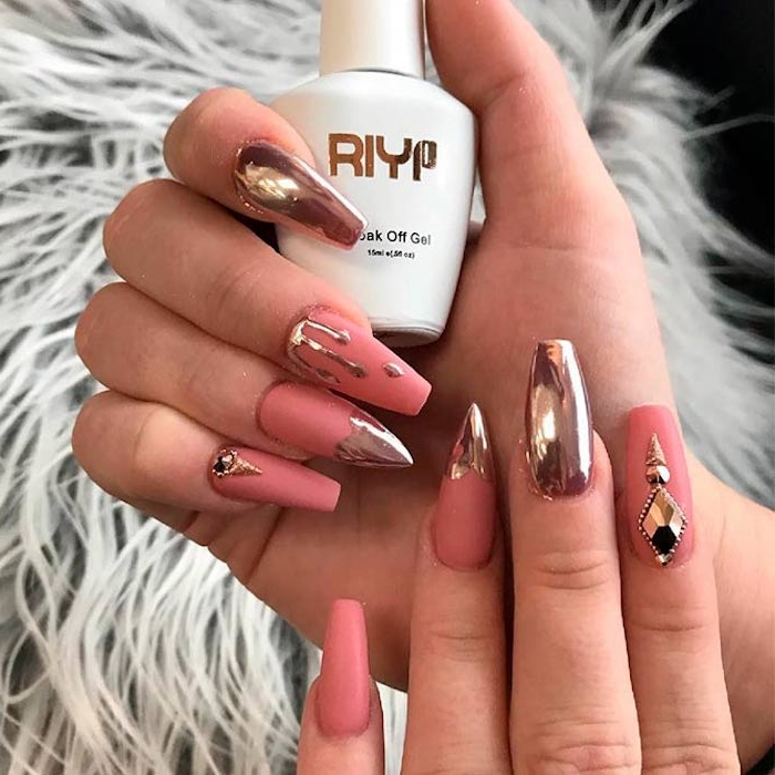 dripping effect detail, and rose gold metallic decorations, on two hands, with oval nails, most have square tips, but two nails have sharp tips