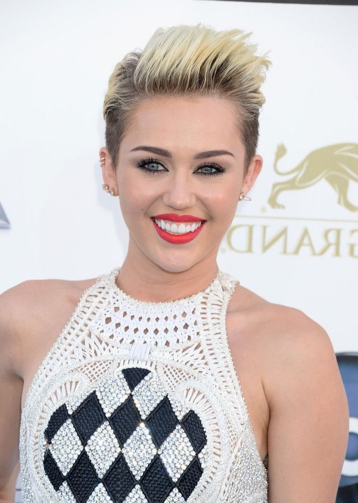 knitted white sleeveless top, with black and diamante beads, worn by miley cyrus, with a blonde faux hawk, hairstyles for fine thin hair, with dark roots