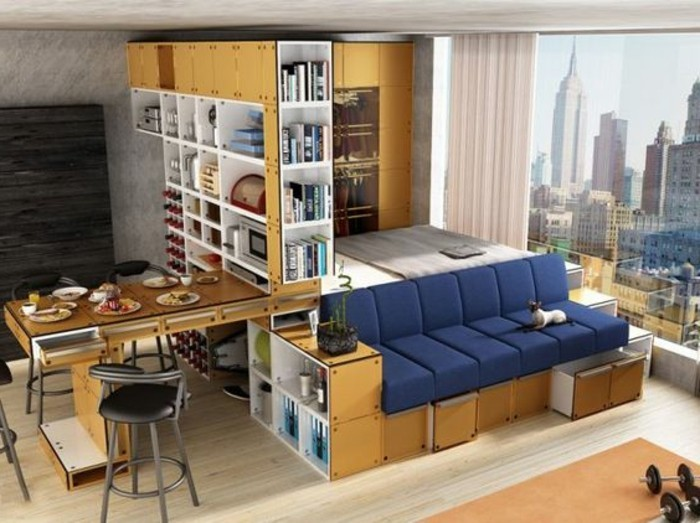 foldable furniture inside a studio flat, navy blue sofa, with storage compartments, dining table with four black chairs, couches for small living rooms, large window with a city view