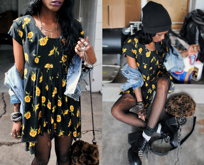 sunflower pattern in bright yellow, on a black mini dress, 90s outfit ideas, worn with fishnets tights, and a denim jacket, by a young black woman, in a black beanie hat