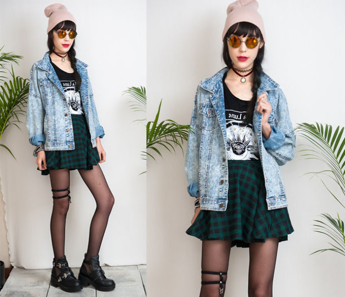 grunge goth style outfit, green and black checkered mini skirt, black t-shirt with print, acid wash denim jacket, round sunglasses and a beanie, 90s halloween costumes