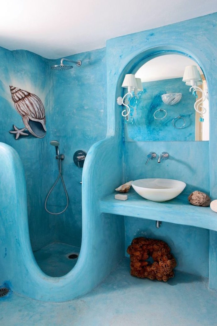 conch shell and starfish, hand painted on the turquoise walls of an unusual, diy bathroom, brown decorative coral and a mirror