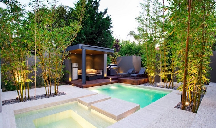 metal gazebo with a sofa, near a modern off-white pool, surrounded by bamboo plants, small backyard pool ideas