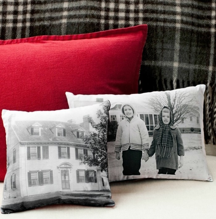customized white cushions, with greyscale images, of a large house, and two children holding hands, last minute birthday gifts, large red cushion behind them