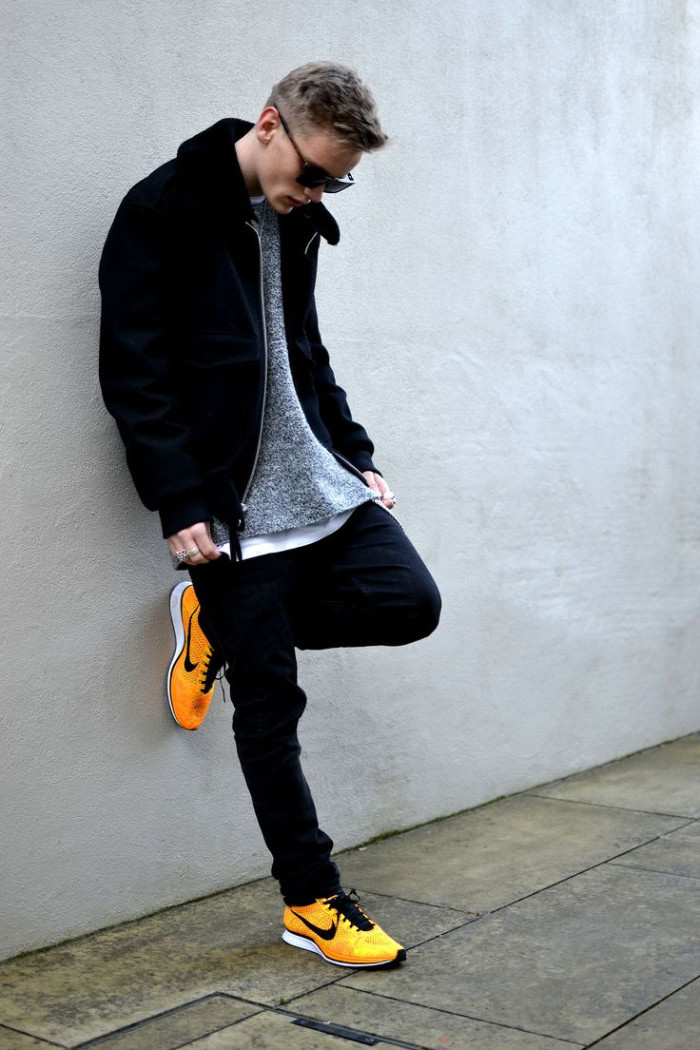 contrasting yellow sneakers, vintage nike shoes, combined with dark jeans, white t-shirt and pale grey jumper, and a black zip-up jacket