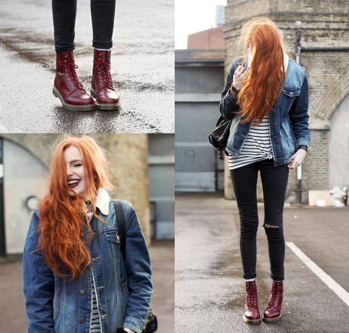 wavy long copper red hair, on slim girl, wearing black ripped skinny jeans, retro denim jacket, and oxblood dr. martens
