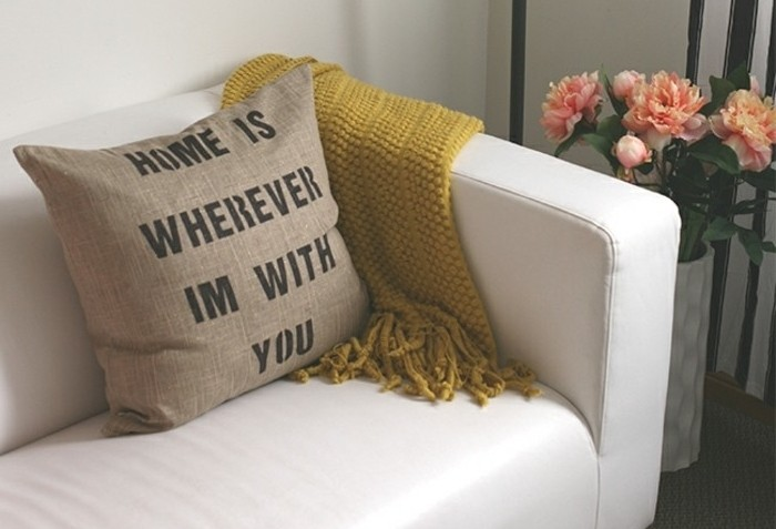 burlap-like cushion in beige, decorated with a romantic message, written in dark grey, homemade gift ideas, on a white leather sofa