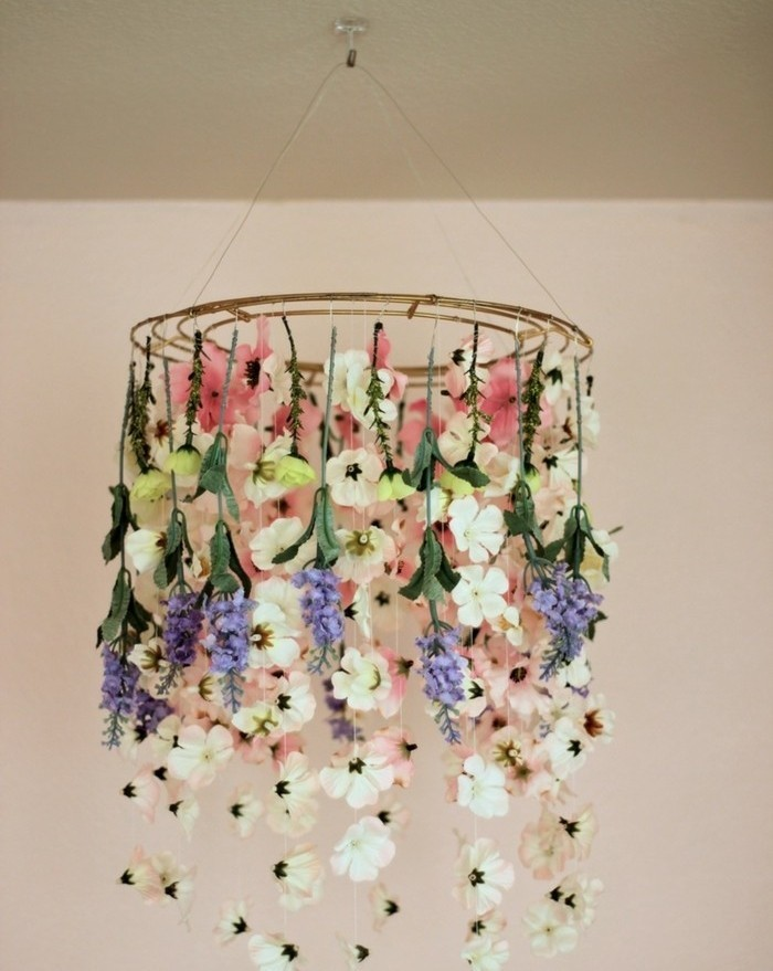 hanging round ornament, decorated with faux flowers, in different shapes and colors, inexpensive thank you gift ideas, suspended from the ceiling on a string