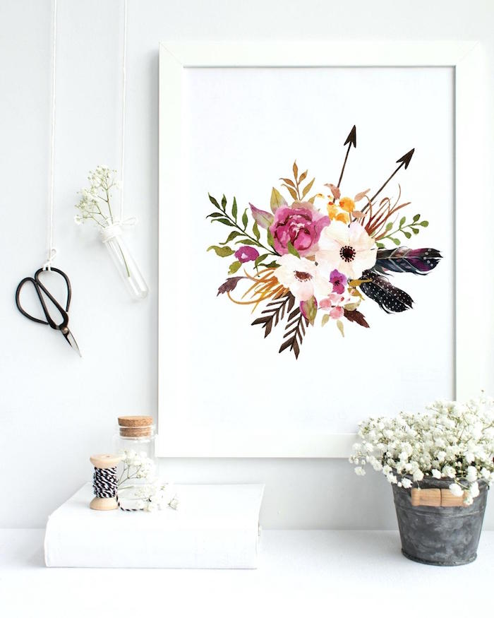 small bathroom decorating ideas, close-up of a flower drawing, in a white frame, mounted on a white wall, decorated with a pair of vintage scissors, and a small vial, containing a white flower, hanging from a white string, little bucket filled with white flowers