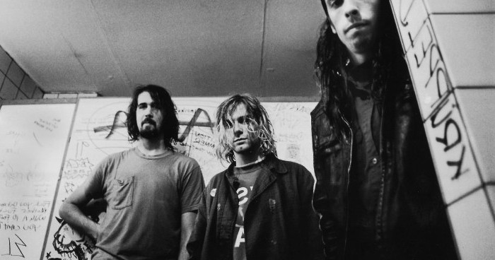 nirvana members in a black and white image, 90s aesthetic, kurt cobain and dave grohl, with krist novoselic, grunge style icons