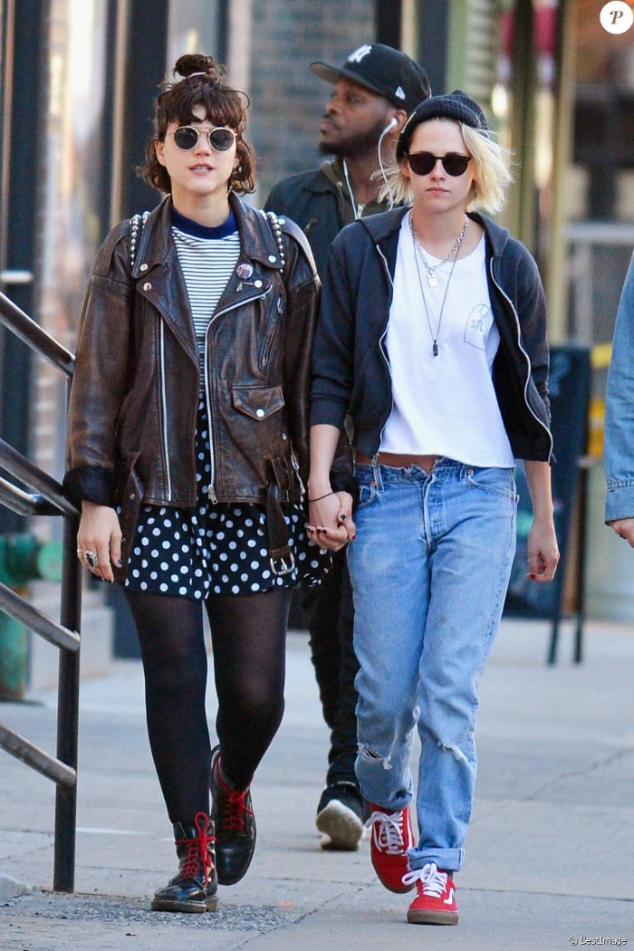 bomber jacket in black, over white t-shirt, and unbuttoned baggy jeans, brown studded leather jacket, with striped top, and polka-dot skirt, worn by kristen stewart and her girlfriend