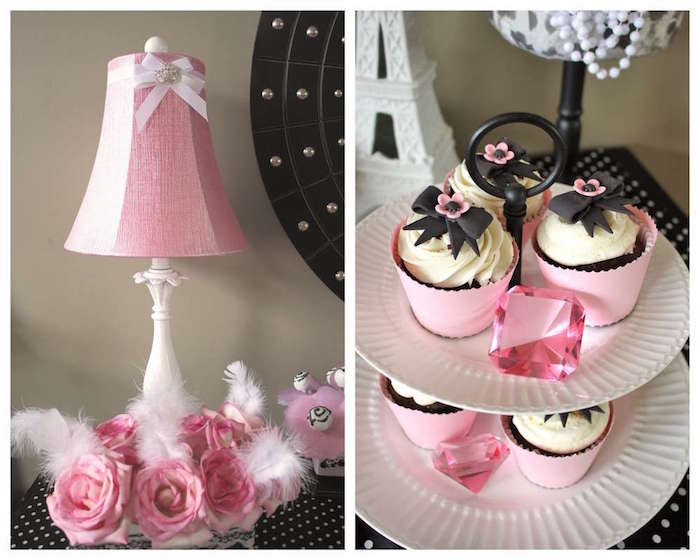 close up of a dish on two levels, with several cupcakes, and pink gem decorations, 60th birthday party ideas for mom, next image shows a lamp, with a pink lampshade, with feathers and pink roses