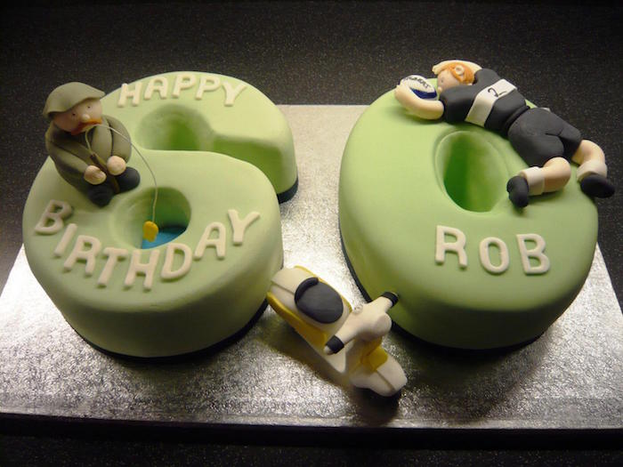 two piece cake, shaped like a 6 and a 0, covered in light green fondant, and decorated with 3 small shapes, happy 60th birthday, fishing man and footballer, tiny cream and black scooter