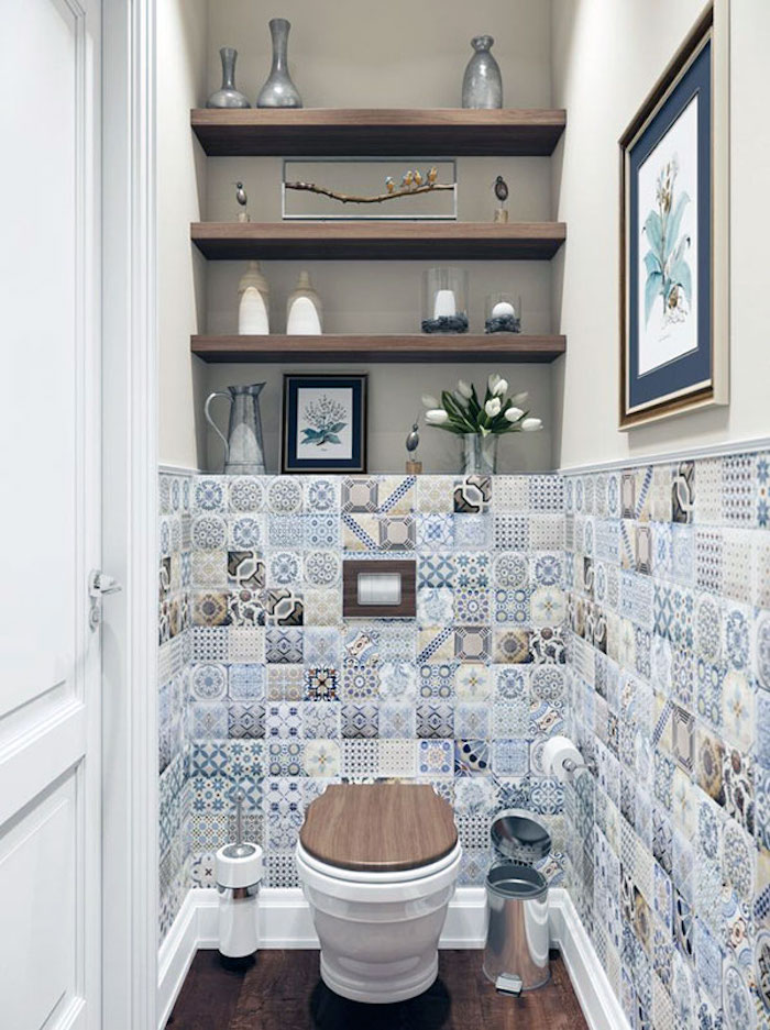 small bathroom décor, patchwork of multicolored moroccan tiles, with different patterns, in a narrow room, with a toilet, and three shelves