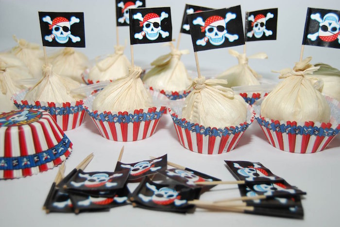 sweets in white, red and blue wrappers, each decorated with a small black flag, bearing a pirate's logo
