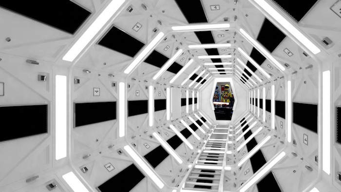 2001: a space odyssey, hexagonal tunnel in black and white, with glowing white fluorescent lights, impressive movie set designs