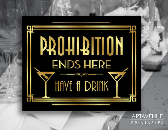 prohibition ends here, have a drink, written in gold letters, on a black art deco sign, with two drawings, of cocktail glasses
