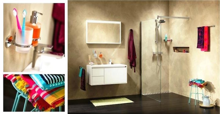 fabrics in colorful patterns, toothbrushes in popping colors, and vibrant towels, in a minimalistic room with beige wash walls, containing a shower, and a white cupboard, with inbuilt sink