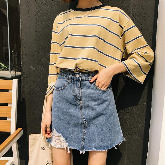 yellow striped top, with 3/4 sleeves, worn tucked into a high waisted denim skirt, with ripped detail, 90s clothes womens