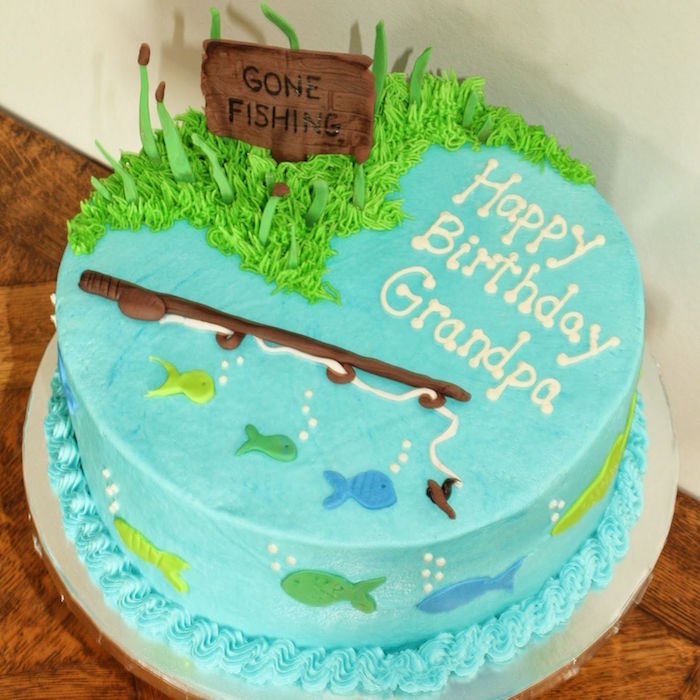 teal round cake, decorated with a fishing rod, several small fish shapes, green grass and a brown sign, with the inscription gone fishing, all made from colorful fondant, happy 60th birthday, cake ideas for grandpa